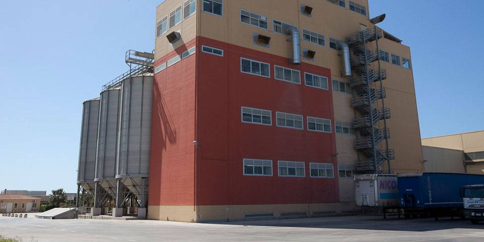Industrial building in Sicily with storage silos
